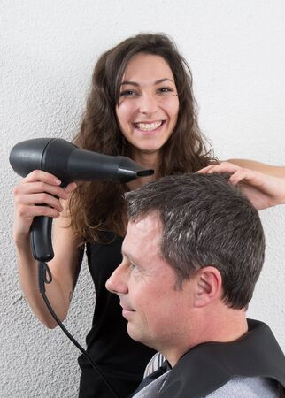 coiffeur: Man at the hairdresser,  drying his hair with a blow dryer