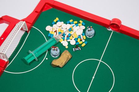winning bid: Figures of football players on euro banknotes, syringe and pills