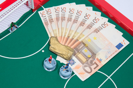winning bid: Figures of football players on euro banknotes,  syringe