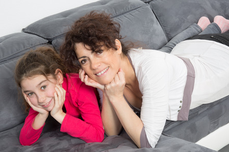 family tickle: bright picture of hugging mother and daughter Stock Photo