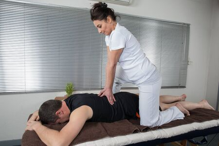 one man: One man and woman performing back  massage