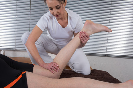 Foot and legs massage, alternative therapy photo