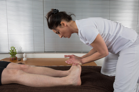Shiatsu massage by a woman therapist photo