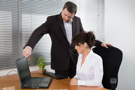 A businessman presenting his product to the woman