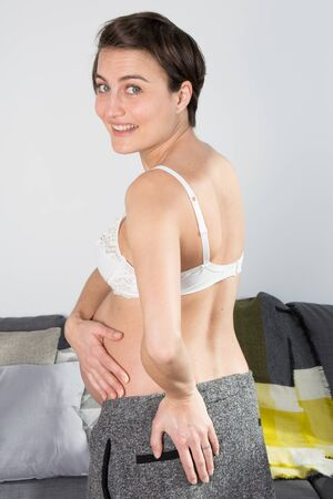 a pregnant woman on a white background photo