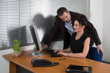 businessgroup: a manager  and  his secretary a  business team