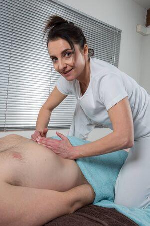 shiatsu: A man Receiving Shiatsu Treatment From a woman Stock Photo