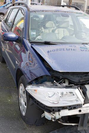 fender bender: A blue wrecked car Stock Photo
