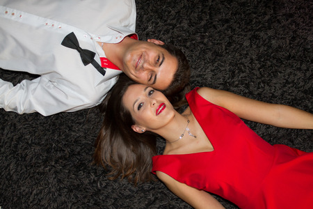 Young couple lying on the carpet photo