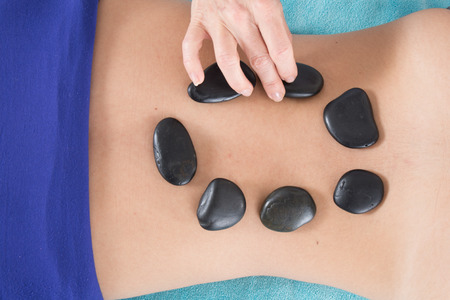 hot stone massage: Adult woman having hot stone massage in spa salon. Beauty treatment concept.