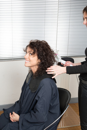 hair stylist: Stylist blow drying hair of a client at the beauty salon
