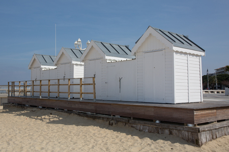 White wooden huts or cabins on the beach photo