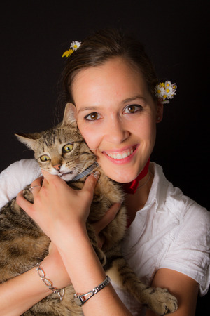 catechism: A cute and a young woman with european cat