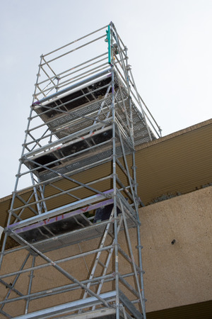 A urban apartments wall restoration works and scaffolding construction photo