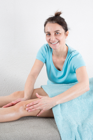 ankles: Beautiful young woman is ready for ankles massage at  spa Stock Photo