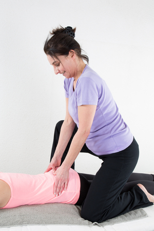 therapeutical: Beautiful woman enjoying massage and body treatment isolated on white
