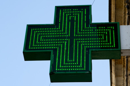 cure prevention: Pharmacy sign or Drug store symbol (Green cross) Stock Photo