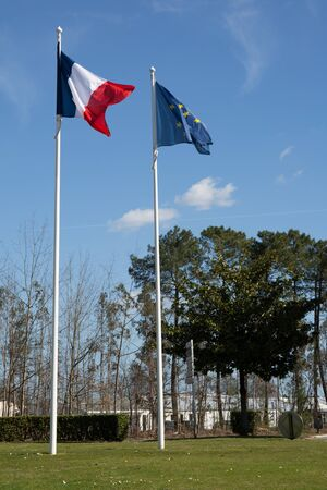 european economic community: Flag of France and European union flags over a blue sky