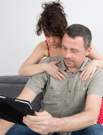 40 45 years: Nice couple using a tablet computer