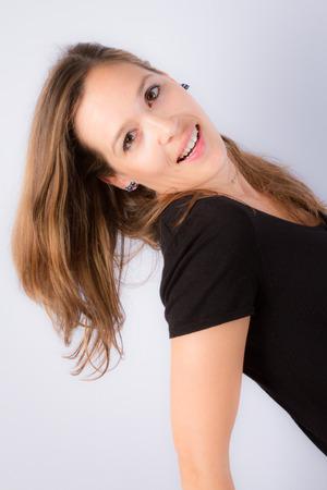 slinky: Young brunette lady in black dress
