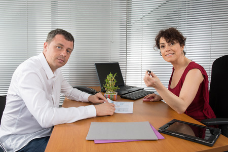 employers: Office people. two employers working in team for the company success