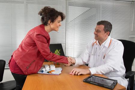 prophylactic: Doctor receiving  a woman Pharmaceutical Sales Representative Stock Photo