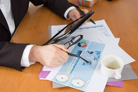 analyzed: Close-up of graphs and charts analyzed by business people