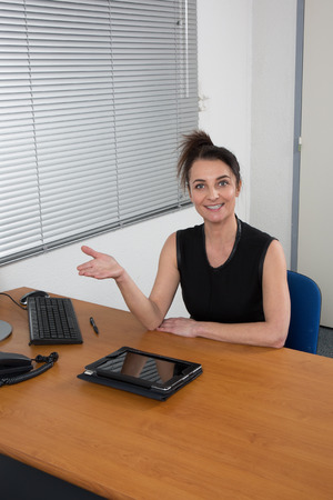hr: Smiling HR woman having job interviews and receiving candidates Stock Photo