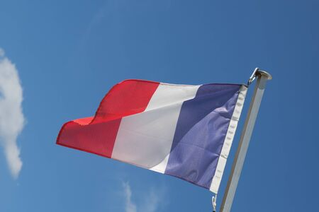 flagpoles: The french flag over a blue sky