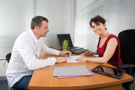 Businessman And Businesswomen Having Informal Meeting In Office photo