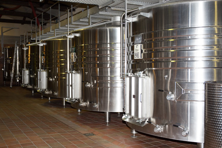 vats: Stainless steel wine vats in a row inside the winery Editorial
