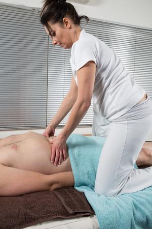 Shiatsu massage by a therapist photo