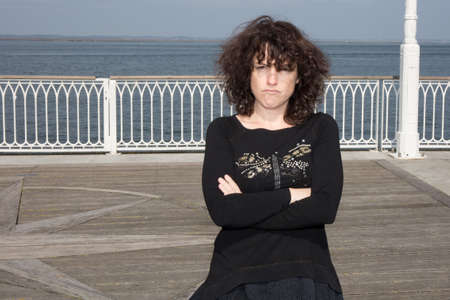 30 34 years: Unhappy brunette in black blouse looking angry and serious