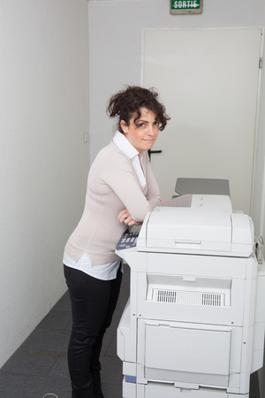 photocopy: Businesswoman making copies on the photocopy machine at the office