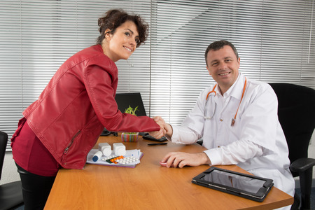 antirheumatic: Doctor receiving  a woman Pharmaceutical Sales Representative Stock Photo