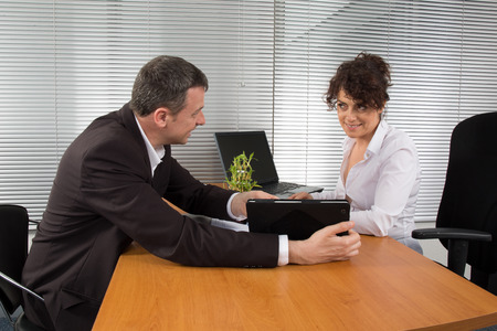 conversing: Two business people conversing and negotiating