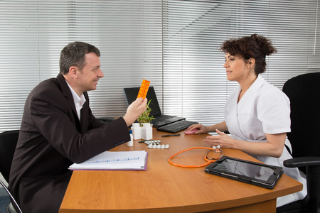 antirheumatic: Businessman with Female Doctor at her office