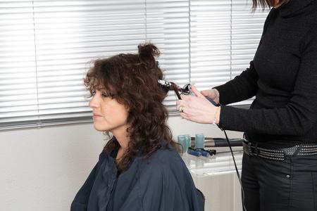 curler: Hairdo with electric hair curler by a hair dresser
