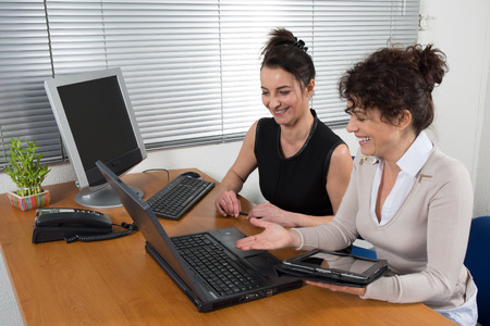 Two employees talk to about the business project  in her office Banque d'images