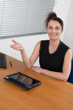 Smiling HR woman having job interviews and receiving candidates photo
