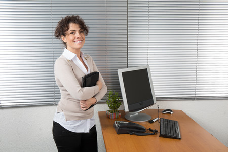 Smiling business woman, in a modern office.