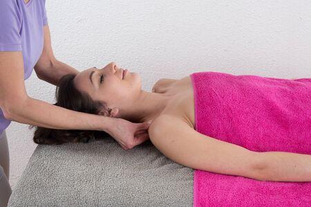 therapist: therapist doing shoulder massage
