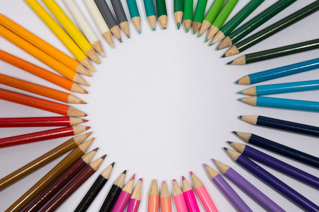 arranged: Smiling sun arranged from crayons and pencil Stock Photo