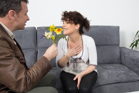 first date: Couple meeting on a casual first date indoors on sofa