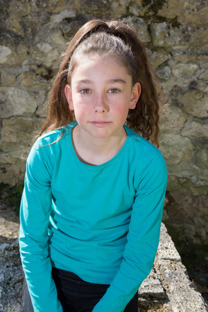 Sweet little girl outdoors photo