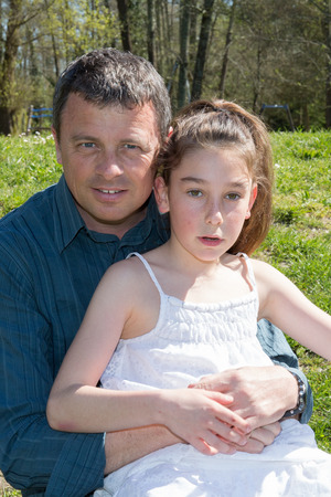 10 years old: Girl, 10 years old with her father outside