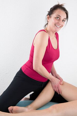traditional healer: Beautiful young woman getting legs massage