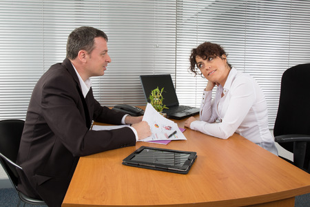 Businesswoman discussing with male colleague photo