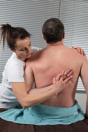 acupressure hands: A man Receiving Shiatsu Treatment