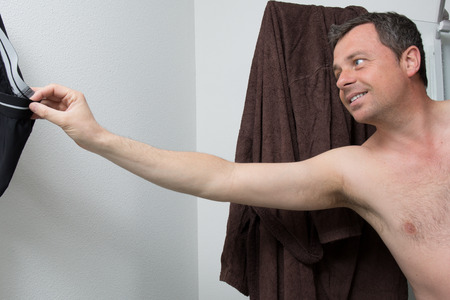unshaven: Unshaven man in his bathroom Stock Photo